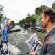 Fly board pilot presents Armin van Buuren with first physical copy of 'Embrace' at Amsterdam Dance Event